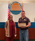 Ms. Laikha Aziz, Volusia Medical Supply, pictured with Les Gillis, City Manager