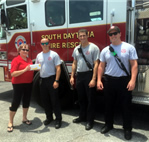 Angie Warga, New Life Martial Arts, donating PPE equipment to Fire Department personnel.